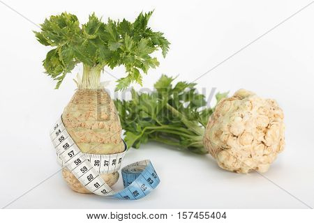 Loosing weight with celery vegetable, white background