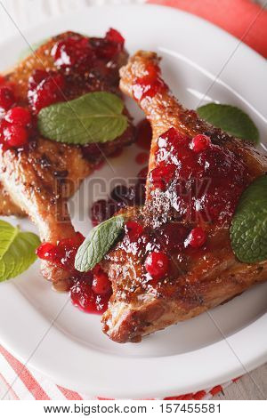 Roasted Duck Leg With Cranberry Sauce And Mint Closeup. Vertical