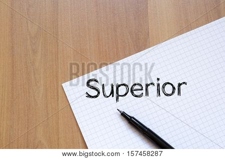 Superior text concept write on notebook over wooden background