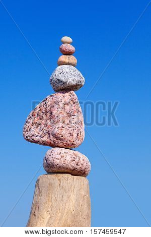 Balance and poise stones. Rock zen on the background of blue sky