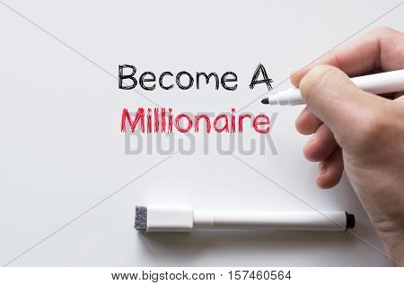 Human hand writing become a millionaire on whiteboard