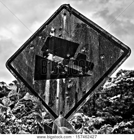 Rusty Road Sign - Cool Descent In Holes From Bullets.