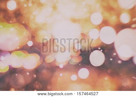 background with natural bokeh defocused sparkling lights. Colorful metallic texture with twinkling lights. Bright and vivid colors