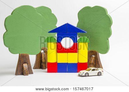 House Of Wooden Blocks, Wooden Figures Of Trees, Euro Money, Model Cars, Keys