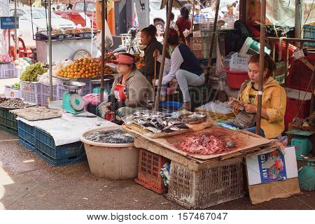 PAKXE, LAOS - FEBRUARY 25, 2016: People on the daily market of Pakxe on February 25, 2016 in Laos, Asia