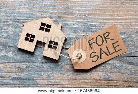 Small house attached to for sale sign