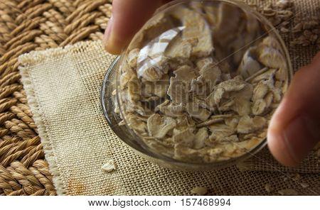 raw oatmeal. oatmeal through the glass. raw oatmeal