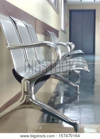 Image of metal seats in waiting area