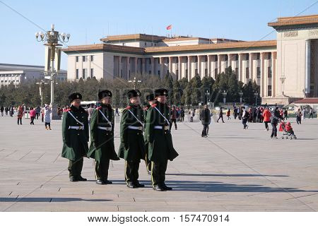 BEIJING, CHINA - FEBRUARY 23: Chinese soldiers march in Tiananmen square. It's the third largest square in the world and important site in Chinese history, in Beijing, China on February 23, 2016.