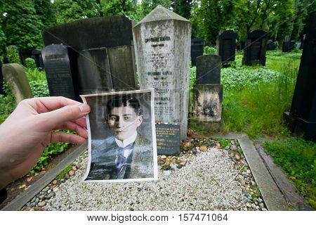 PRAGUE - JUNE 13, 2014: Gravestone and retro portrait of the writer Franz Kafka on the New Jewish cemetery on June 13, 2014 in Czech Republic. Kafka 1883 - 1924 was a German-language novelist