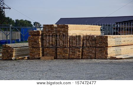 Folded New Board At The Construction Base. Timber. Board Of Pine