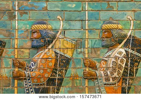 BERLIN, GERMANY - SEPT 2, 2015: Two soldiers of historical empire with bows and spears ceramic patterned wall of city Babylon on Septemper 2, 2015. Artifact of Iraq saved by Pergamon Museum in Berlin
