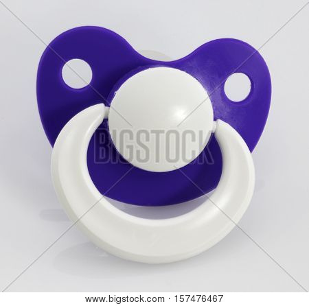 The orthodontic pacifier isolated on a white