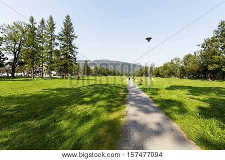 ZAKOPANE POLAND - SEPTEMBER 13 2016: Large meadow that is divided by many paths in fact it is park which is named Rowien Krupowa. This name comes from the surname of the former owners of the meadows