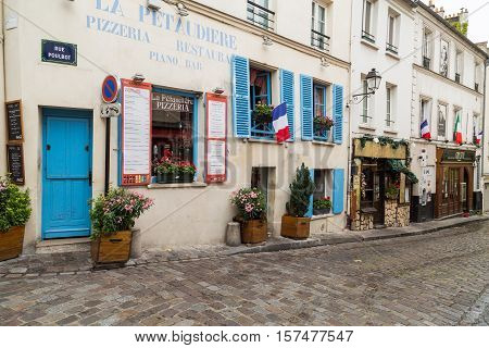 PARIS FRANCE - 28TH JULY 2016: The outside of buildings in Montmartre Paris during the day.