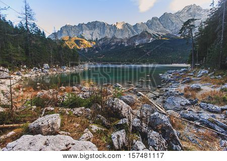 Beautiful vibrant landscape with sundown on mountain lake Eibsee, located in the Bavaria, Germany, near Zugspitze mountain, Alps, Europe.