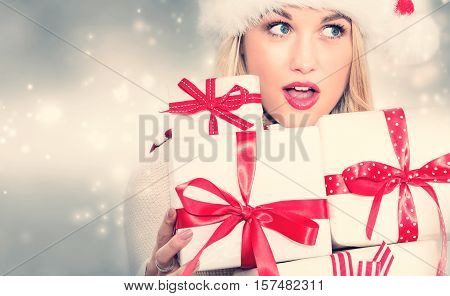 Young Woman Holding Many Present Boxes