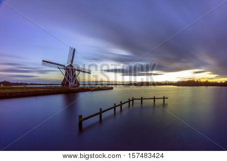 Wooden Windmill Under Long Exposure Sunset