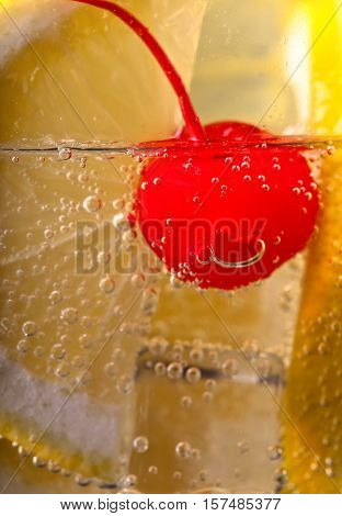 Carbonated Drink With Lemon And Sweet Cherry
