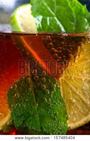 Cold Carbonated Drink With Lime, Ice And Peppermint