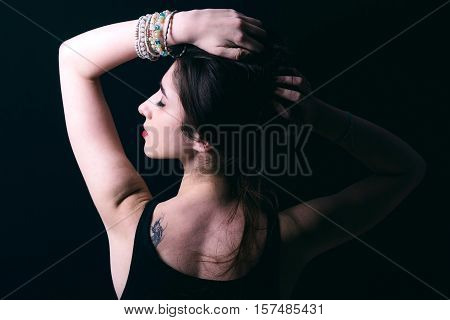 Portrait of beautiful woman in low key