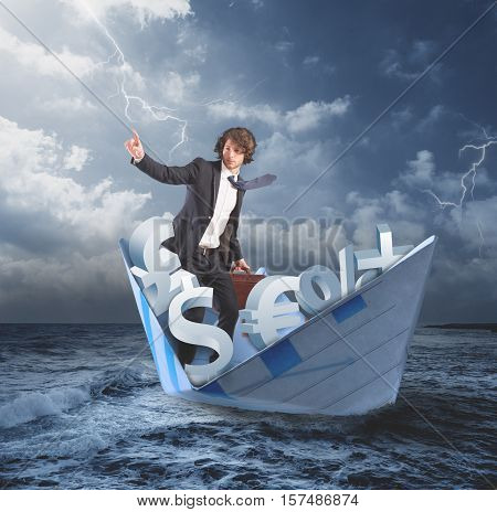 Man on a paper boat in a stormy sea. businessman confident in a better future coming out of the financial and economic crisis concept