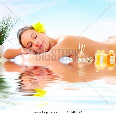 Beautiful young woman getting spa massage. Relax