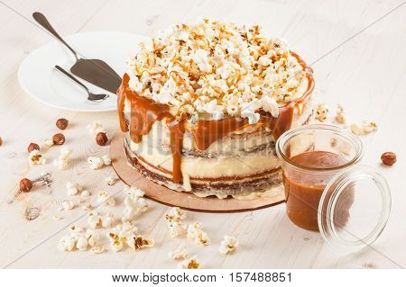 Homemade cake with hazelnuts and salty caramel with vanilla - hazel shortcakes and delicate hazelnut cream, decorated with salty popcorn.