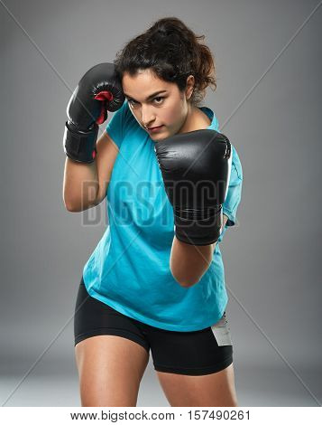 Latino Female Fighter Throwing An Uppercut