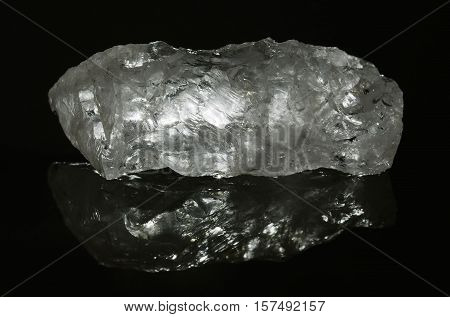 Quartz Raw Crystal Horizontal With Reflection And Isolated Over Black