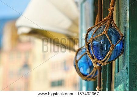 two decorative glasses blue buoys on old wood door