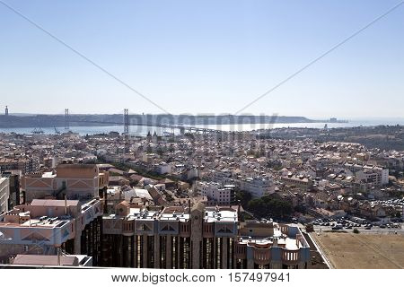 LISBON, PORTUGAL - September 30, 2016: Panoramic view from the newest Amoreiras Lookout Point in Lisbon Portugal towards the Tagus River with the 25th of April Bridge in the background