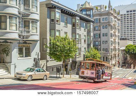 San Francisco, California, United States - August 17, 2016: the Cable Car, Powell-Hyde lines, full of tourists along the famous Powell Street, the most famous and tourist tram line of San Francisco.