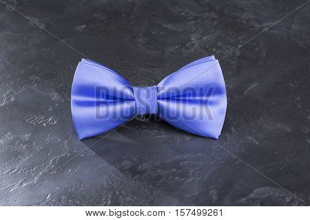 Bow tie on a beautiful dark gray background.