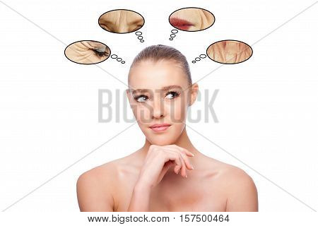 Beautiful clean face of woman looking to side thinking about aging and wrinkles aesthetics exfoliating skincare concept on white.