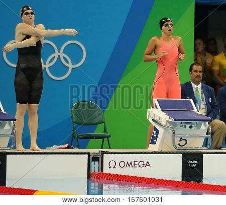 RIO DE JANEIRO, BRAZIL - AUGUST 8, 2016: Lilly King of United States (L) and Yulia Efimova of Russia before Women's 100m Breaststroke Final of the Rio 2016 Olympic Games at Olympic Aquatics Stadium