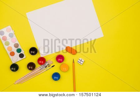 School table or desk seen from above. Top view product photograph. Shool or university concept image. Back to school background.
