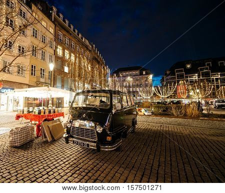 STRASBOURG FRANCE - DEC 24 2015: Old Renault van selling old books with Christmas Market decorations in French city of Strasbourg Place Kleber