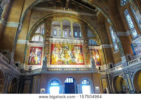 Lisieux France - September 7 2016: Inside the Basilica of Saint Therese of Lisieux in Normandy. The richly decorated walls and ceiling