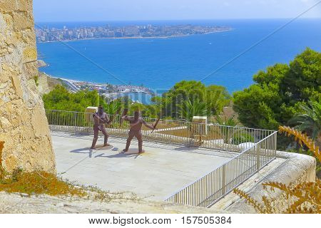 ALICANTE SPAIN - AUGUST 31: two figures of warriors of metal fighting on the castle of santa barbara. Picture taken on August 31 2016 in Alicante Spain