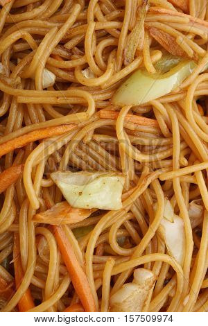 Chinese dish. Chinese food. Spaghetti with vegetables. Closeup.