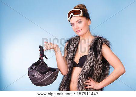 Woman Wearing Bra And Holding Ski Helmet