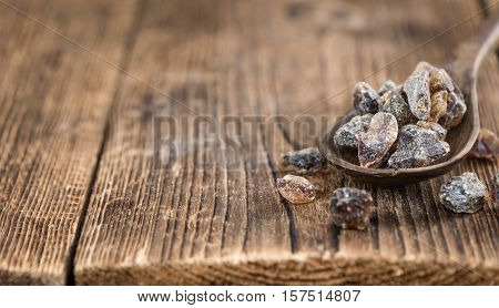 Brown Rock Candy On Wooden Background
