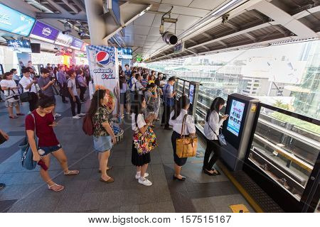 BANGKOK, THAILAND, OCTOBER 03, 2016 : Passengers queueing for waiting the BTS train urban transportation in Bangkok, Thailand