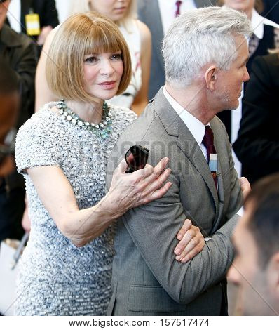 NEW YORK-MAY 5: Anna Wintour (L) and Baz Luhrmann attend the ribbon cutting ceremony for Anna Wintour Costume Center Grand Opening at the Metropolitan Museum of Art on May 5, 2014 in New York City.