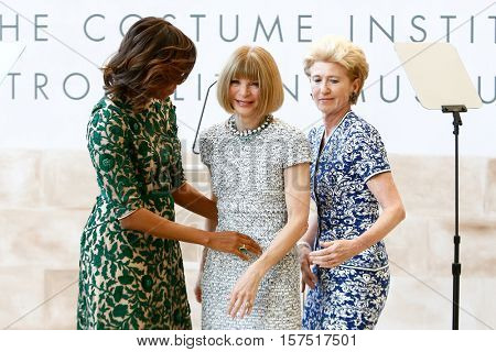 NEW YORK-MAY 5: (L-R) Michelle Obama, Anna Wintour and Emily K. Rafferty at the Anna Wintour Costume Center Grand Opening at the Metropolitan Museum of Art on May 5, 2014 in New York City.