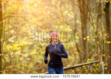 Smiling sportswoman runs in morning