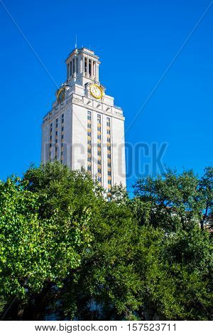 Sunny day at University Campus in CEntral Texas UT Tower looking up at the tall Landmark of Education in Austin Texas USA blue sky background