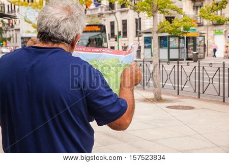 SANTANDER SPAIN - AUGUST 19: Man tourist with map on the street on August 19 2016