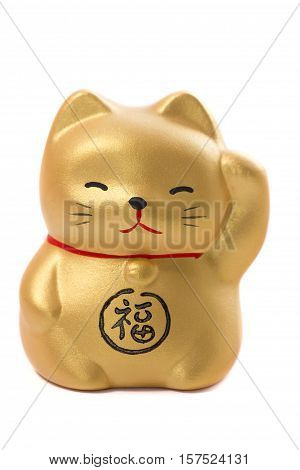 Golden japanese fat lucky cat and wealth ceramic talisman isolated on white background